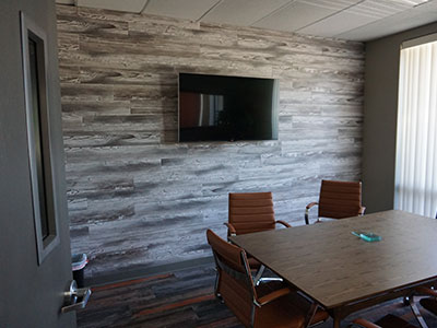 wood vinyl accent wall in conference room